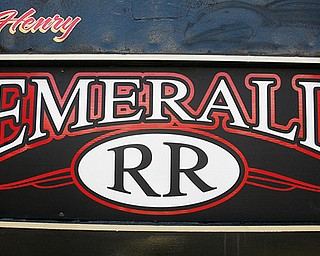 LOCAL RAILROAD: The Emerald Railroad logo appears on the vintage railroad cars on display behind the Emerald Diner.