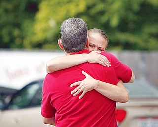 SORROWFUL HUG - Two patrons hug each other as police investigate a roped off area next to Freddie's Diner. One person was shot to death and another seriously wounded Tuesday during a robbery at a North Park Avenue restaurant and social club. Police are looking for at least one black man who went into Freddie's Diner, 1125 North Park Ave., to rob it shortly before 9 a.m.