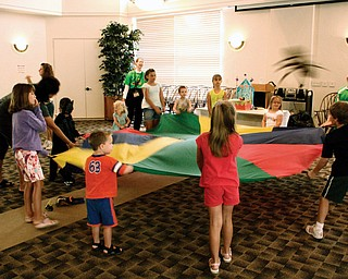 Children play with the parachute activity at Austintown Library. (ok)