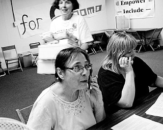 Volunteers Shirley Matyi of Austintown, left, works with Volunteer Darlene White of Austintown soliciting support for Barack Obama over the telephone at the Democratic candidate's new office on Market Street.  Thursday, August 22, 2008.