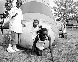 L-R Teasia Lambert, 11, of Youngstown; Kevin Maghan, 9, of Youngstown Travon Tinsley, 4, of Youngstown and Tamiara Branch, 11, of Youngstown at Community Day at the Rockford Village in Youngstown Saturday, August 23, 2008.
