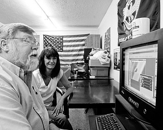 ONLINE: Gregory Wedin, a coach at the Post 290 Career Center in vienna, and manager Joann Stevens check out one of the Internet-based programs for Ohio veterans.