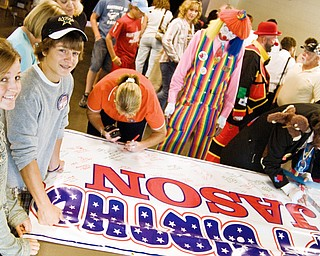Chrysa Kovach, 17, and her brother Beau Kovach, 15, wait in line for a marker to sign a banner which will serve as Baird's birthday card a the Jason Baird Fundraiser Sunday, August 24, 2008.