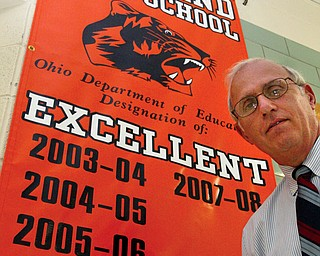 Howland High School principal Frank Thomas with a banner in the hallway of the school.