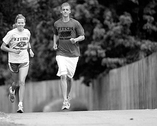 Fitch Cross Country runners Shannon Rech and Josh McHenry.