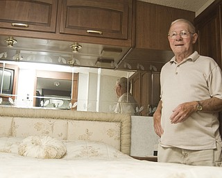 Bill Ward is camped at the Canfield Fair in a 37 ft. Tasko Horizon trailer. Here he is posing in bedroom, Saturday, August 30, 2008. Daniel C. Britt.