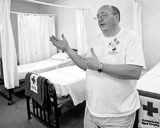 PATIENT READY: Alan Scannell, Red Cross event coordinator, talks about the splints, blisters and bee stings that are treated at the Canfield Fair. Scannell said he expects the number of patients to be up as the weekend brings sunny weather.