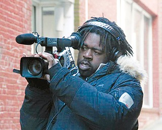 FOCUSED: Youngstown native Derrick Jones follows his passion for filmmaking with a documentary about inmates accused of murder during a riot at the Southern Ohio Correctional Facility in Lucasville. He has been awarded a prestigious grant for his work.