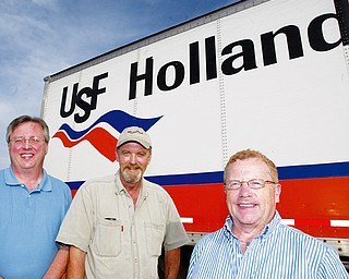 A GOOD DEED INDEED: USF Holland Trucking Co. employees, from left, Bob Praft, operations supervisor; Gary Speelman, driver; and Jim Chandler, assistant supervisor, were involved in helping return lost jewelry to George and Karen Scull of Kirsey, Pa.