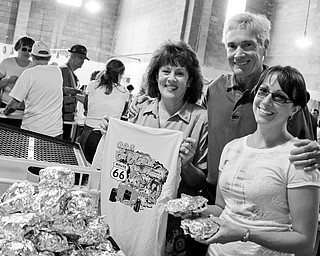 FAMILY AFFAIR: Linda Glenn, Pastor Frank Glenn and daughter Beth Glenn check out some of the offerings at the 13th Annual Glenn Christian Foundation and Church's Ox Roast car show at the Trumbull County Fairground.