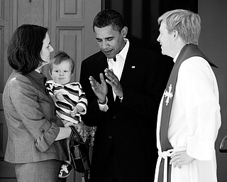 AFTER CHURCH: Democratic presidential candidate Sen. Barack Obama of Illinois, center, talks with Pastor Lars Olson and his wife, Pastor Katherine Olson, and son, carl Olson, 11 months, after going to church at St. Luke's Lutheran Church in Lima, Ohio. Obama attended a service there Sunday.