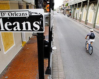 LONELY: A bicyclist rides through the French Quarter of New Orleans. Most of the city has been evacuated.