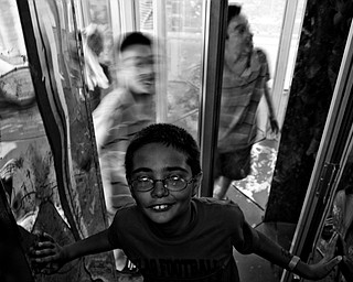 Randy Rogensky, 11, of Hubbard beats his friend out of the maze of mirrors. Daniel C. Britt.