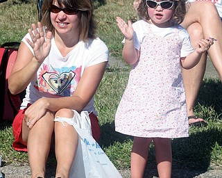 PARADE ROUTE: Renee Combine of Sharpsville and her daughter, Ava, 2, were among those who gathered to watch the parade that was part of the annual Buhl Day festivities in Hermitage. The parade and activities took place Monday.