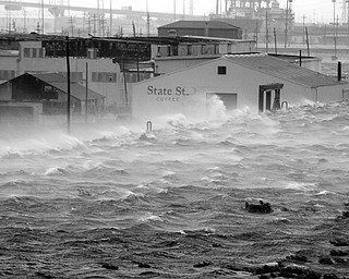 OVER THE WALL: Wind-driven water sloshes over the floodwall along the Industrial Canal as Gustav, weakened to a Category 2 hurricane, slides into New Orleans. THe levees held Monday.