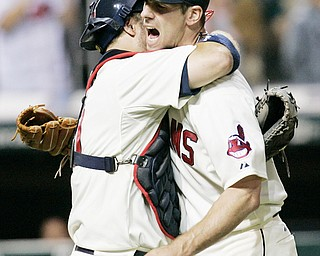 20-GAME WINNER: Indians catcher Kelly Shoppach, left, hugs pitcher Cliff Lee after a 5-0 shutout of the White Sox. Lee is the Tribe's first game winner in 34 seasons.