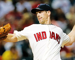 MOUND RENOWN: Indians lefty Cliff Lee throws home during the fourth inning of Monday's game against teh White Sox at Progressive Field. Lee tossed a five-hit shutout to win his 20th game.