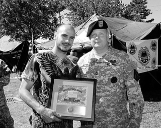 MILITARY SUPPORT: MILITARY SUPPORT: Middleweight Champion Kelly Pavlik accepts an Appreciation Award from Sgt. 1st Class Mark Hutton of the Army National Guard in recognition of Pavlik's support of the military. Pavlik wore boxing trunks featuring an American flag with the insignias of the five branches of the military for his June bout with Gary Lockett.