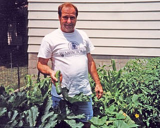 Robert Bushman of Boardman Township grows cucumbers, eggplant, onions, tomatoes, peppers and herbs, which he shares with friends and neighbors. (Photo from Patricia Bushman)
