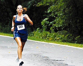 TUNED IN: Diane Villanueva of the Anthem team competes in the 10K relay at Mill Creek Park. The YOungstown Community Cup compeition concluded Saturday.