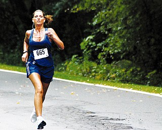 TUNED IN: Diane Villanueva of the Anthem team competes in the 10K relay at Mill Creek Park Saturday. The Youngstown Community Cup concluded Saturday.