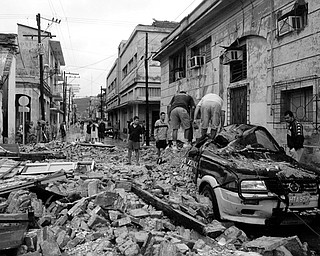 HURRICANE DAMAGE: A car sits under rubble after Hurricane Ike hit in Holguin, Cuba. Ike, which raked the Bahamas and worsened floods in Haiti that have killed 321 people, made landfall on Cuba as a Category 3 hurricane, then weakened MOnday to a Category 1 as it ran along the length of the Carribean's largest island.
