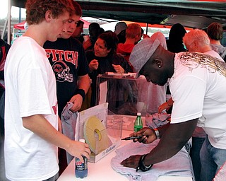 Pittsburgh Steelers' Nick Eason signing autographs at Blitz's tailgate party before the Austintown Fitch vs. Canton McKinley Game.