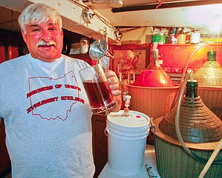 BREWMEISTER: Richard Tomory of Campbell is a prize-winning brewer who has produced award-winning beer concoctions from this nook in his basement. His 2002 mead - a honey-based alcoholic drink - took the gold medal in the annual American Homebrewers Association national competition.
