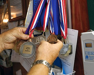 GREAT BREW: Richard Tomory has amassed an extensive collection of medals and awards for his home-brewed beer, mead and cider. The 1966 Campbell Memorial graduate, now 60, took up the hobby as a young man and was a charter member of the Great Northern home Brewers Club in Alaska, where he lived 31 years.