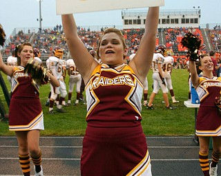 """South Range Senior Cheerleader Tizzy Baytos encourages the fans to yell GO!"""