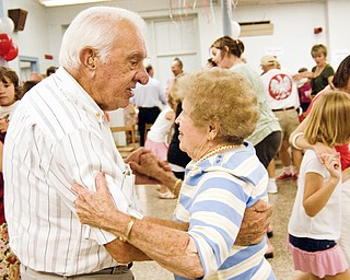 CUTTING A RUG: Bernie and Helen Jakobowski of Canfield show the Youngstown set how it's done as they dance at the Polish Day party at St. Casimir Roman Catholic Church in Youngstown. The event was hosted by the Yougnstown Polish community Sunday. Several hundred people turned out.