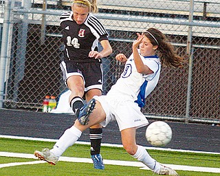 RIVALS: Meredith Gleichert (14) of Canfield and Tatum Marucci of Poland battle for the ball during a recent game.