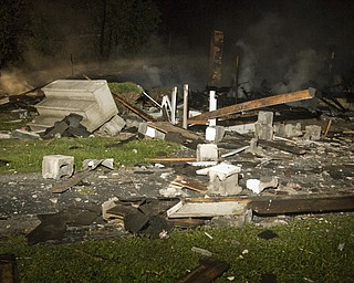 Debris from the explosion covered surrounding houses and lawns. Daniel C. Britt.
