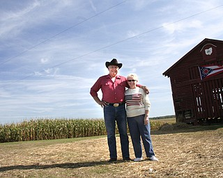 Linda and Henry Lipps stand near their cornfield where John McCain appeared on GMA.