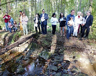 Re-enacting Tashlich on Rosh Hashana, Rabbi Joseph Schonberger and members and friends of Temple El Emeth tossed bread into a stream flowing through a ravine near the rabbi's home Tuesday afternoon.
