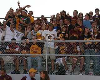 """South Range students cheer on the Raider football team Friday night."""