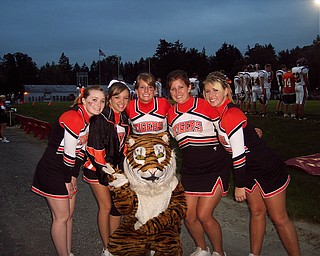 Springfield Senior Cheerleaders Ally Anglin, Courtney Gobel, Kelli Kampfer, Laura Krcelic, Jordan Peshek, and Mascot Heather Cozak, cheer the Tigers to victory at the Columbiana game.