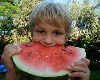 We took our 3 young children to Cyprus this summer to meet their cousins for the first time. As you can see, what they loved most was the Karpuzi (Watermelon)! Alonzo with Karpuzi Jef Davis Poland, OH 44514