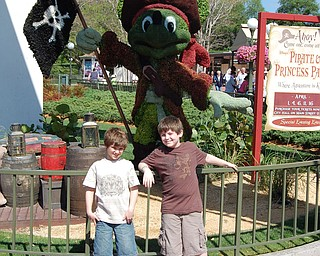 Brothers, Connor, age 10 and Matthew, age 8 celebrate Connor's 10th birthday at Walt Disney World with Mickey Mouse pirate style.  Photo by mom, Kim Yurich of Poland