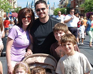 Picture of the The Yurich family vacation to Walt Disney World in Spring 2008.  Mom, Kim, Dad, Joe, Sophia, Dominic in stroller, and big brothers Connor and Matthew, all of Poland.