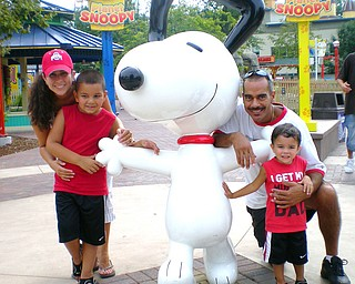 My name is Renee Bero and in August, I took the picture of my daughters' family at Cedar Point. They were really enjoying themselves in the Planet Snoopy kids area.   They are Elizabeth Jorge with Santino Jorge; and Michael Jorge with Alex Jorge.