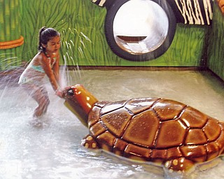 Lindsay Zublena, 5, of Canfield, plays at the Kalahari Waterpark. She went with her parents, Rick and Karen, and her brother, Robby, 9.