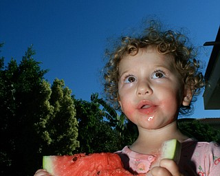 We took our 3 young children to Cyprus this summer to meet their cousins for the first time. As you can see, what they loved most was the Karpuzi (Watermelon)!  Loukia with Karpuzi   Jef Davis Poland