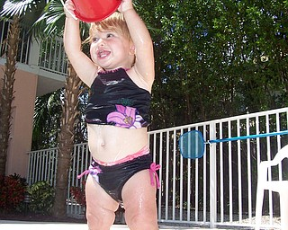 Cali Matey cooling off near the pool while vacationing in Key Largo, Fla. Sent by Kelly Matey, New Springfield.
