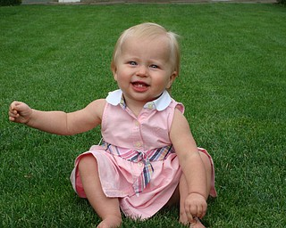 Payton, now 14 months, enjoying the grass between her toes at the Rose Garden in Mill Creek Park. Chad and Alyson Zwingler Canfield