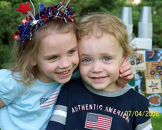 These are my children, Olivia and Matthew, on July 4.  It is one of their favorite holidays.  We have breakfast outside at their grandparents' house in Canfield and then watch the parade from their front yard.  It's become a family tradition. Lisa Rossi Austintown