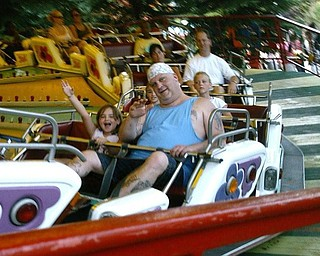 This is my husband, Mark, and daughter, Kylie, on the Music Express at Kennywood Park.  We were celebrating Kylie's 7th birthday. Shannon Thomas Poland, OH  44514
