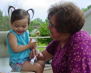 Adriana Trafficante of Boardman enjoying a summer day with Grandma 'Beeps' Ezzo of Youngstown.  Ofcourse treats were involved!  Picture taken by John Trafficante of Boardman.