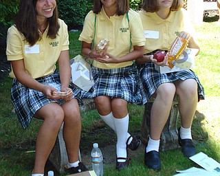 From: Linda Miller August Days at Ursuline High School! Freshmen Olivia Murphy, Taylor Daly, and Lindsay Pratt enjoy a picnic lunch in the Meditation Garden of the Ursuline High School Campus in Youngstown. These friends met at the August 18 Freshman Orientation Day.