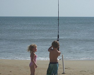 Liam, 4, andMadigan, 3, catching a whopper in Kitty Hawk,NC. Outer banks. Photo from mom Lori Miller of Salem.